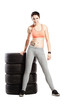 fitness girl with set of tyres