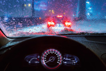 Blurry Car Silhouette Seen Through Snowy And Wet Windscreen