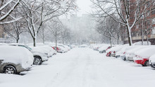 Cars Covered In Snow On A Parking Lot In The Residential Area