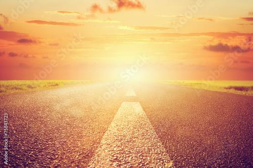 Long empty asphalt road towards sunset sun. Plakát