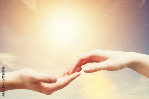Fotografia, Obraz  Soft, gentle touch of man and woman. Sunny sky, vintage mood