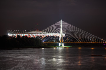Fototapeta Warszawa Night view of bridge and stadium in Warsaw