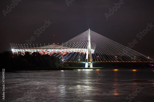 Night view of bridge and stadium in Warsaw #75849922