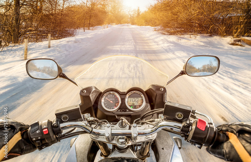 Photo  Biker First-person view. Winter slippery road