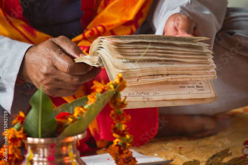 Brahmin reading hindu mantra in Nepal
