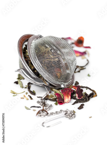 Fényképezés  Green herbal tea with dried flowers in tea strainer