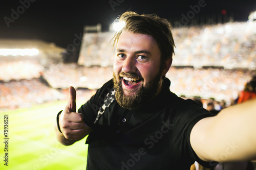 Fotografía  Handsome supporter making selfie at football game in Barcelona