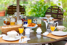 Table Laid For Breakfast Outsi...
