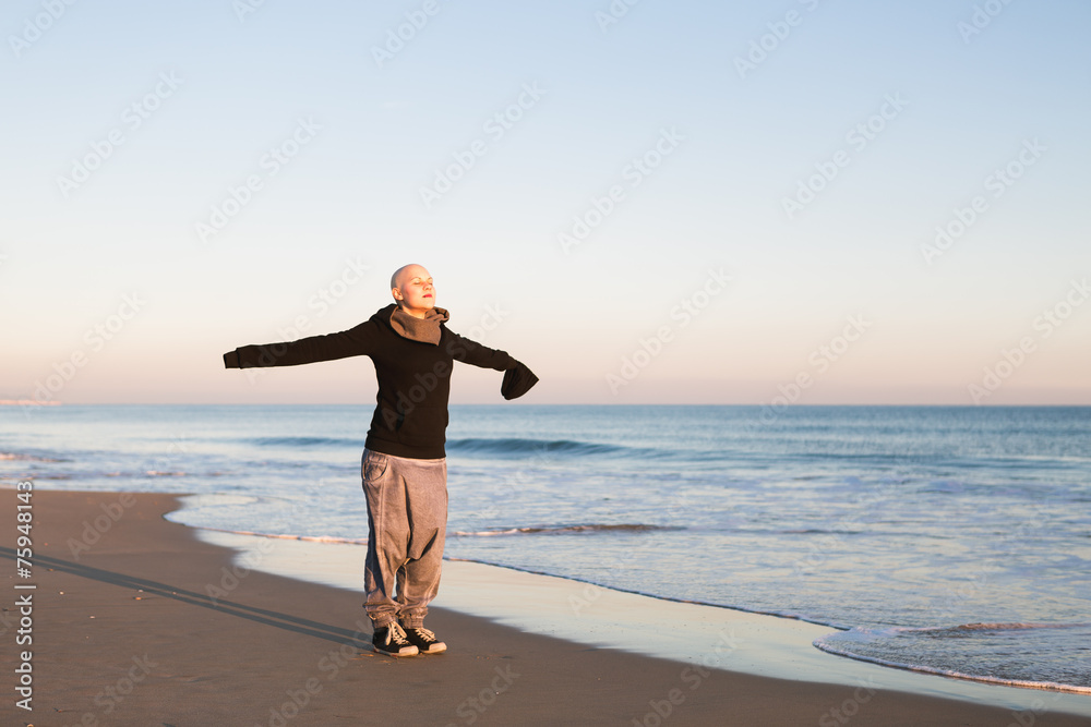 Fototapeta Real Female hairless fight against cancer at the beach