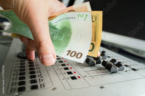 Fotografie, Obraz  DJ hand with currency