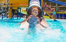 Little Girl On Water Slide At ...