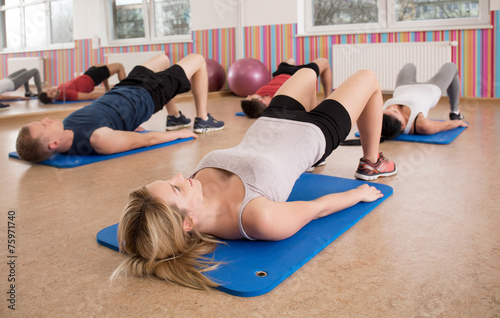 Fotografía  Exercise on gym floor mats