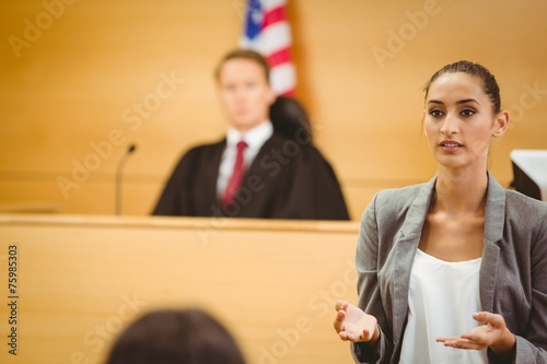 Serious lawyer make a closing statement Fototapeta