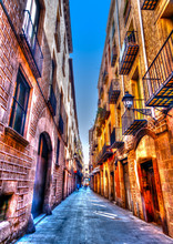 Narrow Road In The Old Center Of Barcelona In Spain. HDR