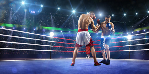 Fototapeta Boks Two professionl boxers are fighting on arena