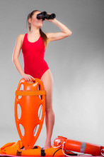 Lifeguard On Duty Looking Through Binocular