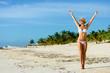 Joyful woman on tropical caribbean vacation