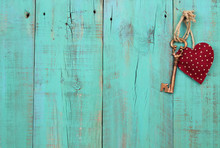 Red Heart And Key Hanging On Antique Wood Background