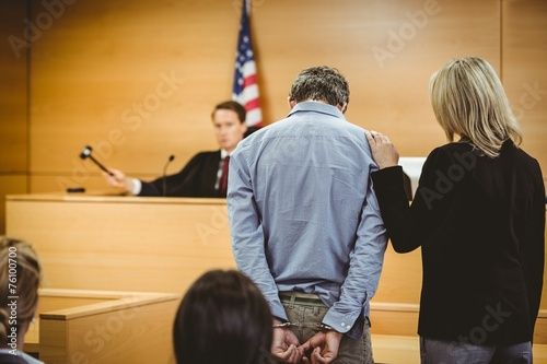 Judge about to bang gavel on sounding block Fototapeta