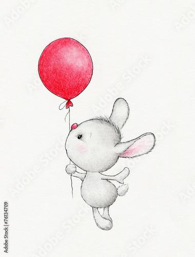 Śliczny królik lata na balonie
