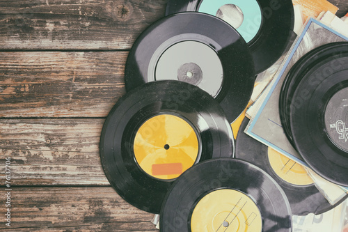 Naklejki dekoracyjne close up image of old records over wooden background , image is