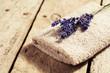 Bouquet of lavender flowers on towel, spa concept