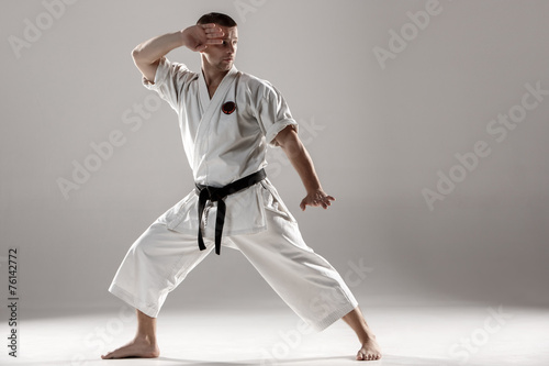 Obrazy Karate   man-in-white-kimono-training-karate