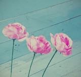 Vintage roses decoration on blue wood background,instagram style