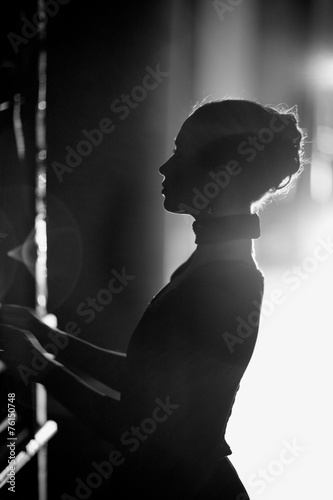 Plagát  Silhouette of a beautiful actress on the backstage, monochrome