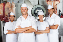 Male Butcher With Confident Team