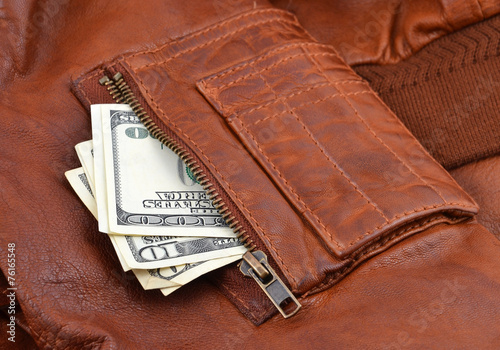 Money in leather jacket pocket with zipper Fototapeta