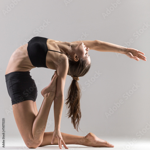 Fotografie, Obraz  Yogi gymnast girl doing asana Ustrasana or Camel Pose