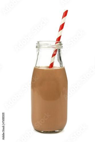 Foto op Plexiglas Milkshake Chocolate milk with straw in a bottle isolated