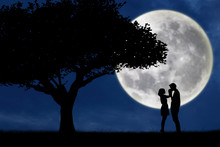 Guy Kiss Girl Hand On Full Moon Silhouette Background