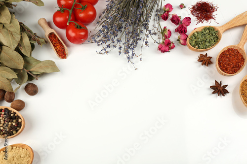 Photo Stands Herbs 2 Different spices and herbs in wooden spoons isolated on white