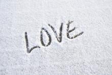 Word Love Written On Fresh Snow