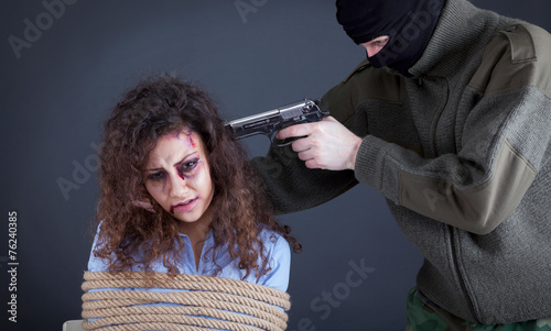 Fotografie, Tablou terrorists threatening the a frightened girl with gun