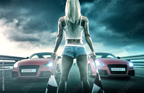 Vászonkép  Sexy blonde woman starts racing