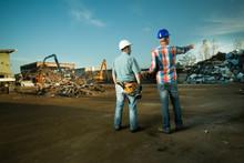 Workers At Scrap Metal Landfill