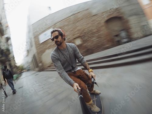 Photo  Man makes turn on his skateboard