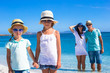 Happy family with two kids during tropical beach vacation
