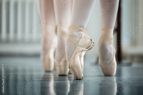 Fotografie, Obraz  Legs dancers on white pointe, near the choreographic training ma