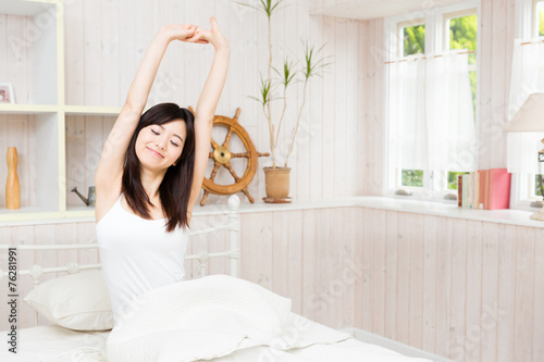 young asian woman in the bed room Canvas Print