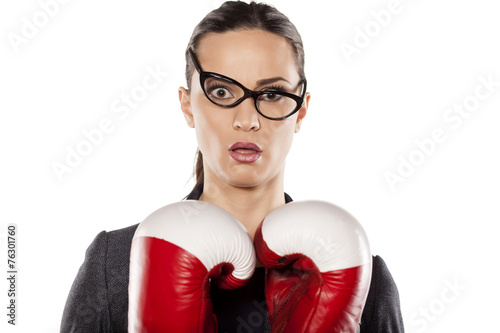 Valokuva  young woman with boxing gloves with a surprised look