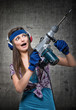 Funny housewife using a jackhammer to drill into wall