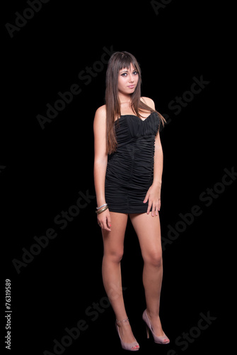 Teen Cute Girl In A Black Dress Over Black Background Buy This