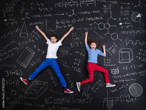 Two schoolkids learning Poster