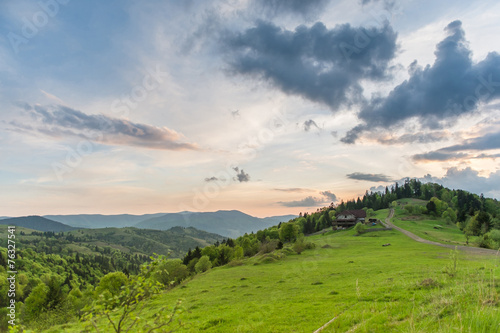 Poster Donkergrijs Landscape with country house and mountains. Spring of Carpathian