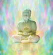 Buddha in peaceful meditation on rainbow colored energy formation background