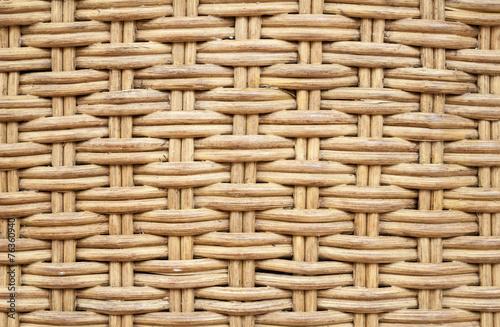Fotografía  Old wicker furniture wall. Closeup background texture